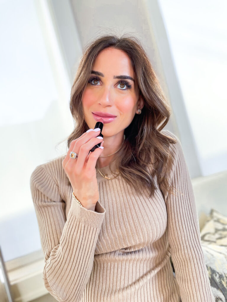 lifestyle and fashion blogger alexis belbel sharing her favorite nude lipstick from NARS available at Nordstrom wearing a sweater dress and snakeskin booties | adoubledose.com