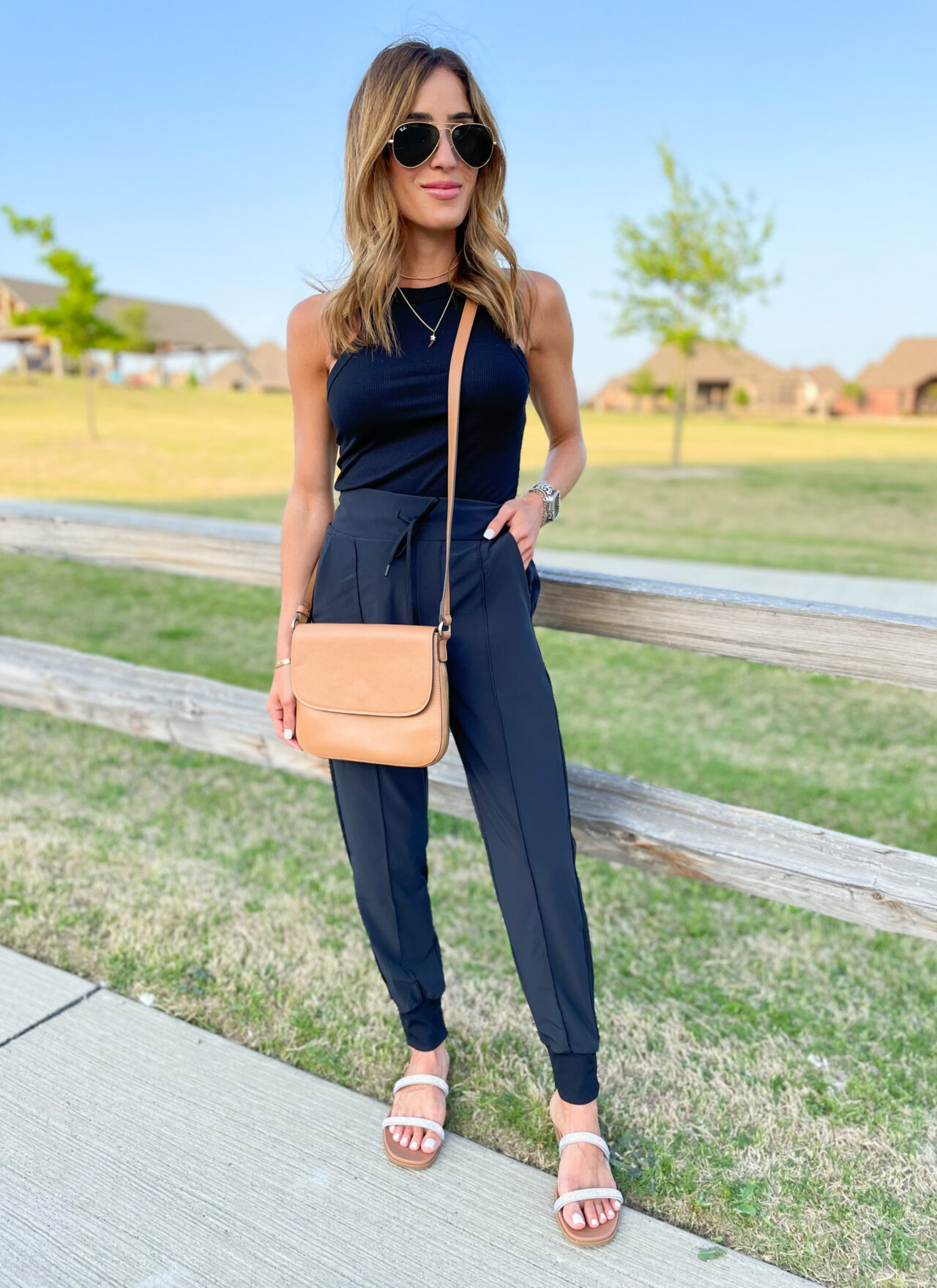 lifestyle and fashion blogger alexis belbel shares a few ways to style woven drawstring joggers from Zella at Nordstrom. Wearing with a black ribbed tank and denim jacket and slide sandals | adoubledose.com