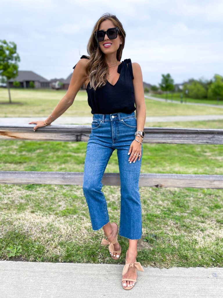 lifestyle and fashion bloggers alexis and samantha belbel share their favorite cropped flare jeans for petites from express and how to style them - with a bodysuit and black tank | adoubledose.com