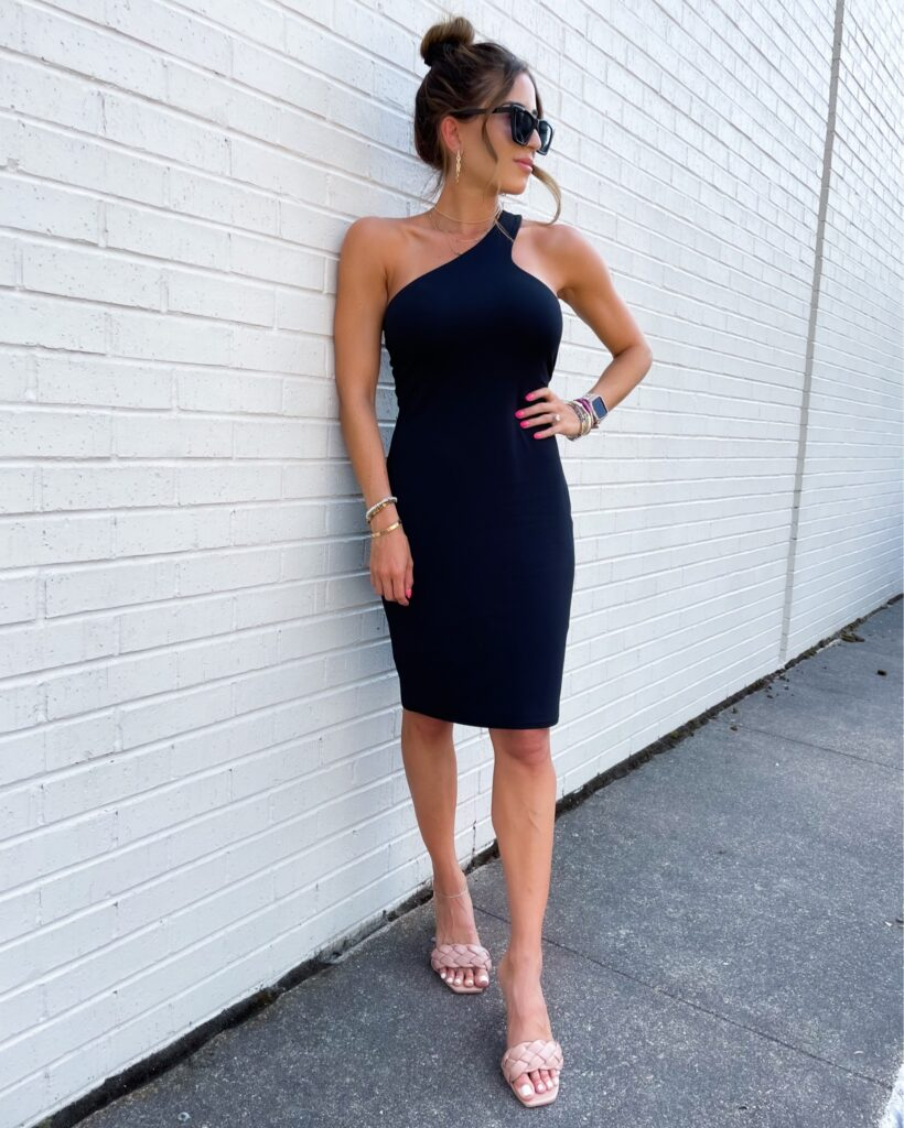 lifestyle and fashion bloggers alexis and samantha belbel share some summer wedding guest dresses from Express: a black asymmetrical dress and a maxi dress with heels | adoubledose.com
