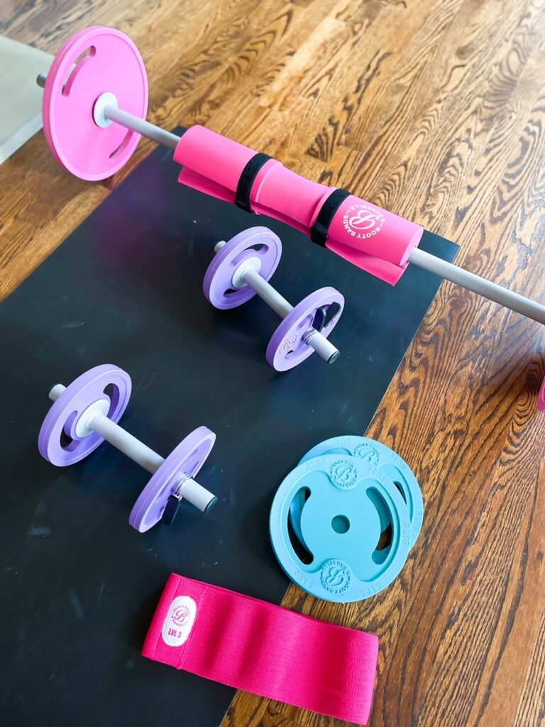 lifestyle and fashion blogger samantha belbel shares a full body at home workout using Booty Bands resistance bands, dumbbells, and barbell   adoubledose.com